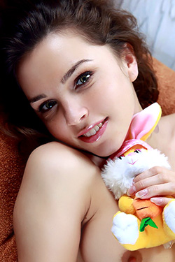Adorable Brunette with Small Lumps and a Bunny for AV Erotica
