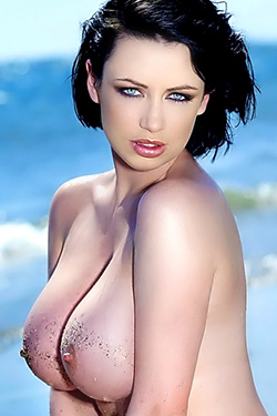 Sophie Howard Shows her Nice Firm Breasts on the Beach