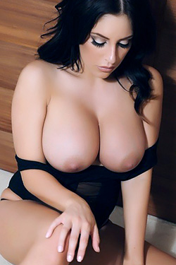 Busty black haired babe Ashley Emma