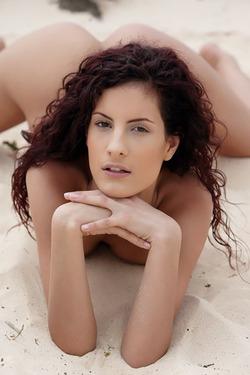 Curly redhead Leanna for Sun Erotica